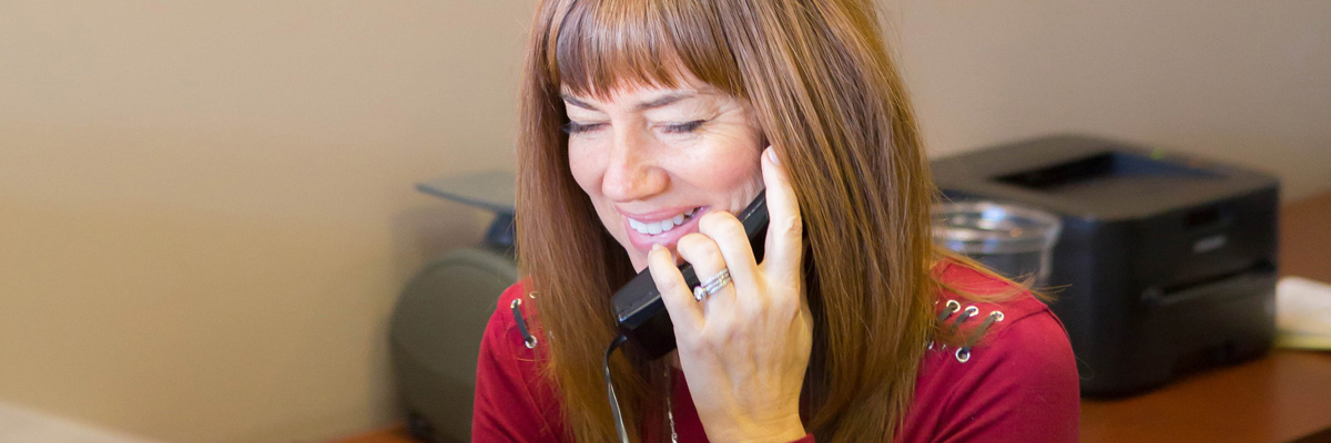 A Roughley Insurance staff member on the phone helping a client