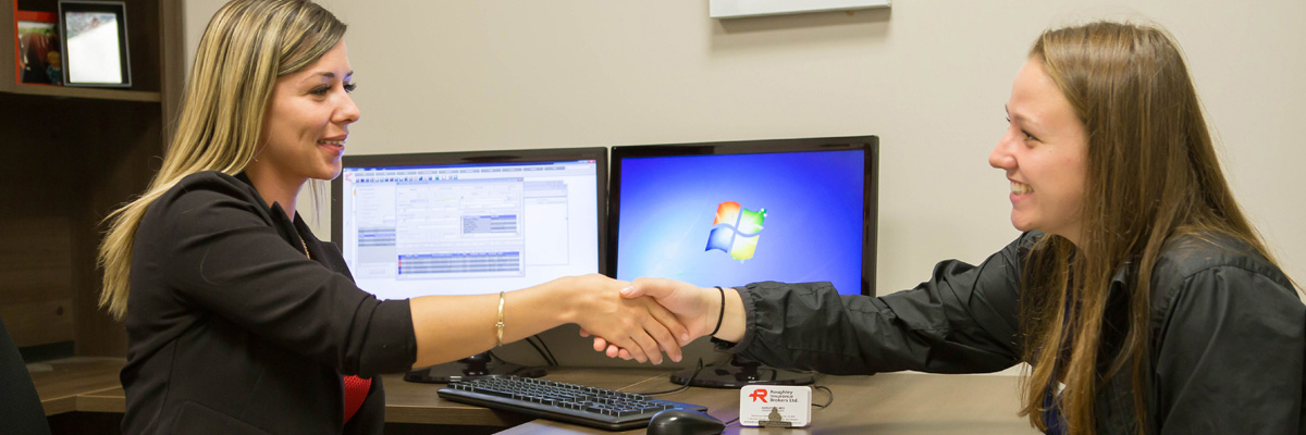 Roughley Insurance staff member shaking hands with a client