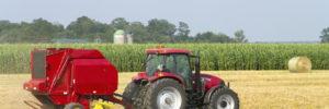 Farm tractor plowing fields on a farm