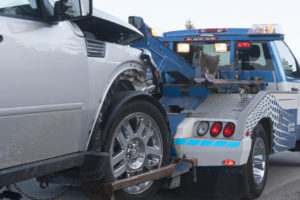 A tow truck towing a pickup truck after and accident in Ontario